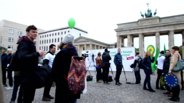 a member of the green party wears a sticker on his jacket with the inscription europe yes in front of the brandenburg gate ska keller and sven... - sticker stock videos and b-roll footage