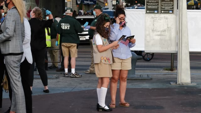 member of the holy cross girl scout troop and her mother read through a 9/11 community vigil pamphlet at the american veterans memorial pier on... - pamphlet stock videos & royalty-free footage