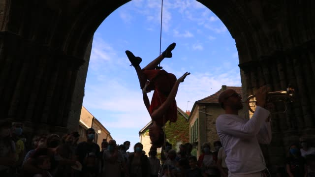 """member of the """"in fine"""" aerial dance company dances suspended from a rope in the ruined nave of the """"saint-mathurin church on september 20, 2020 in... - modern dancing stock videos & royalty-free footage"""