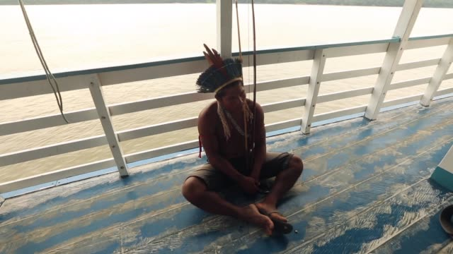 a member of the munduruku indigenous tribe rides along the tapajos river during a 'caravan of resistance'' protest by indigenous groups and... - para state stock videos & royalty-free footage