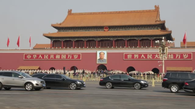 A member of the People's Armed Police stands guard in front of a portrait of former Chinese leader Mao Zedong at the Tiananmen Gate in Beijing China...