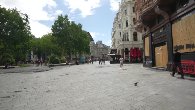 member of the public enjoy leicester square on june 28th more retailers are reopening with social distancing measures after being shuttered for... - infectious disease stock videos & royalty-free footage