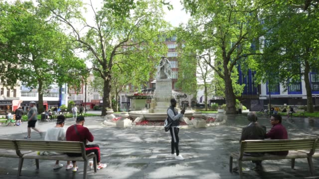member of the public enjoy leicester square on june 28th more retailers are reopening with social distancing measures after being shuttered for... - pandemic illness stock videos & royalty-free footage