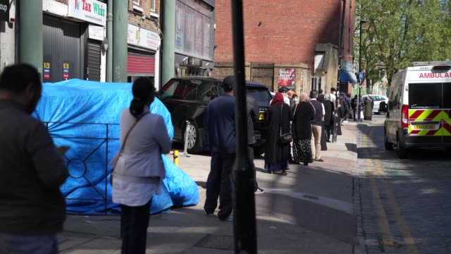 member of the public line up outside barclays bank in east london as the uk government launches their furlough scheme during the novel coronavirus... - furlough stock videos & royalty-free footage