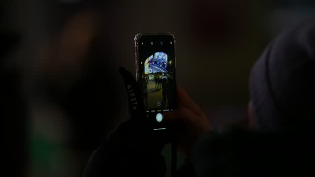 member of the public takes a picture on their smart phone of the advertising screens at piccadilly circus during the livesteam of the landing of nasa... - photographing stock videos & royalty-free footage