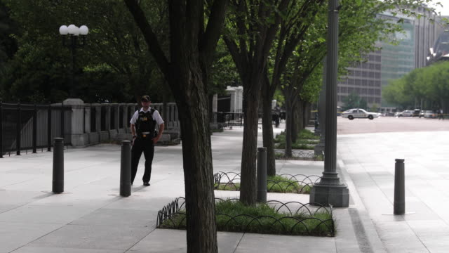 a member of the secret service guards 15th and pennsylvania avenue nw which was closed near the white house after a man set himself on fire and ran... - pennsylvania avenue stock videos & royalty-free footage