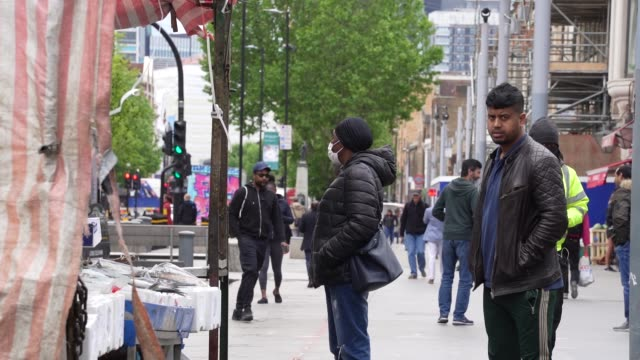 a member to the public wears a face mask at a food market in east london as the prime minister announced the general contours of a phased exit from... - food and drink stock videos & royalty-free footage