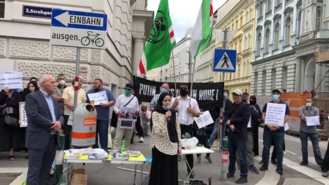members and supporters of the chechen community hold placards on july 07 2020 in vienna during a protest after the murder of martin b a vocal critic... - traditionally austrian stock videos & royalty-free footage