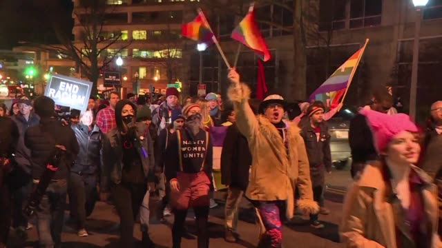 Members and supporters of the LGBT community hold a dance party demonstration against Mike Pence's political stance on LGBT issues near the house...