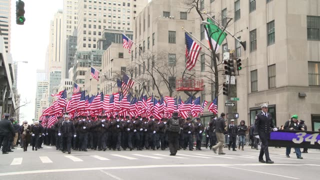 members carry 343 american flags to represent the number of department members killed on sept. 11, 2001 - darstellen stock-videos und b-roll-filmmaterial