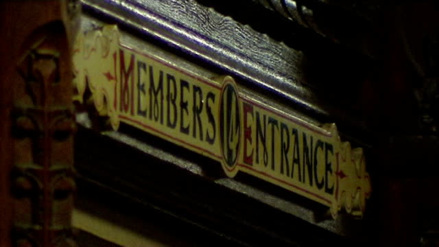 int 'members entrance' sign over door inside house of commons legs of people in corridor - house of commons stock videos & royalty-free footage
