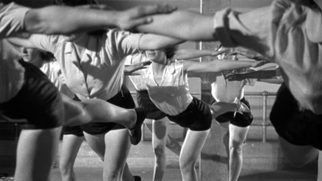 vídeos de stock e filmes b-roll de 1948 montage members exercising and taking part in the different recreational activities at the pioneer health centre in peckham / london, england - peckham