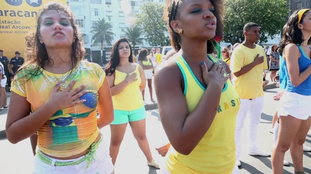 ms members from the group cia dom based in the cantagalo favela listen to the national anthem in copacabana before brazil's 2014 fifa world cup match... - national team stock videos & royalty-free footage