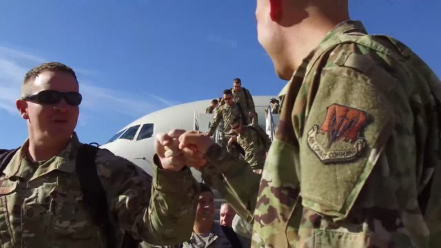 stockvideo's en b-roll-footage met members from us air force 421st fighter squadron return home from deployment in europe to hill air force base utah 30 july 2019 - weduwe