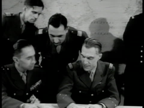 members in meeting large wall map. vs american & english army officers at table talking. vs man at map members at table looking. europe - 1951 stock videos & royalty-free footage