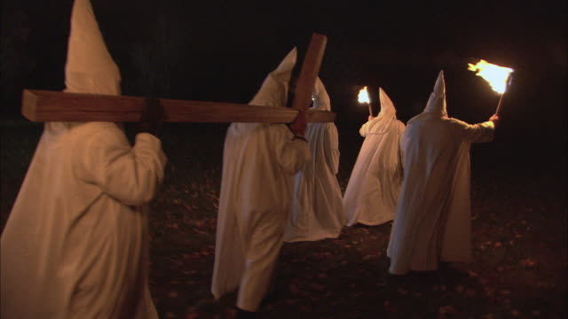 recreation kkk members in white gowns carrying a large, wooden cross and burning torches / rockford, illinois, united states - ku klux klan stock videos and b-roll footage