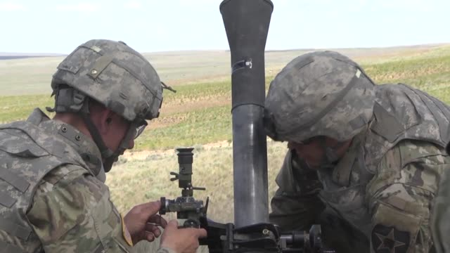 members of 1st battalion, 161st infantry regiment, 81st stryker brigade combat team fire 81mm mortars during annual training at the yakima training... - infantry stock videos & royalty-free footage