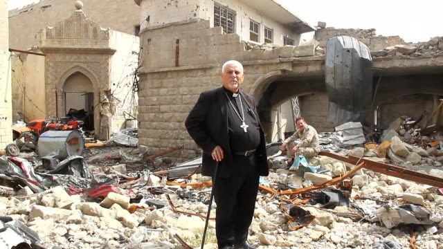 stockvideo's en b-roll-footage met members of a french ngo visit the rubble surrounding mosul's oldest church severely damaged by years of conflict and the occupation of the city by... - kerk