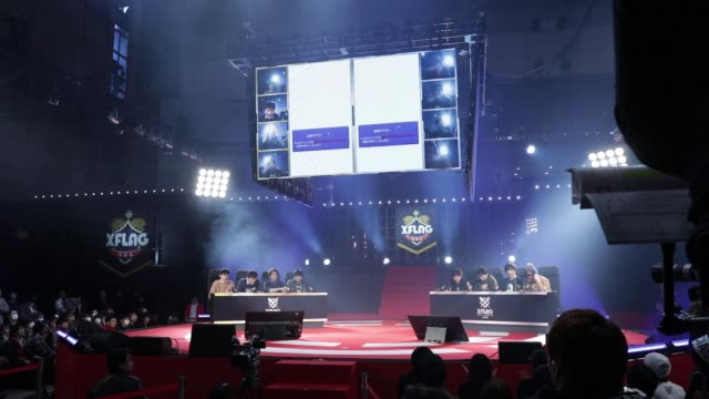 Members of a game team react as they play Mixi Inc's Monster Strike games in a final match during the Tokaigi Game Party Japan esports competition at...