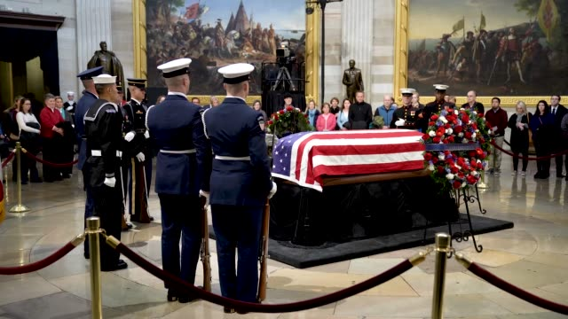 members of a jointservice honor guard perform a changing of the guard as the casket of the late former us president george hw bush lies in state at... - united states congress点の映像素材/bロール