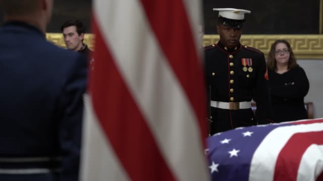 members of a jointservice honor guard stand next to the casket of the late former us president george hw bush as he lies in state at the us capitol... - united states congress点の映像素材/bロール