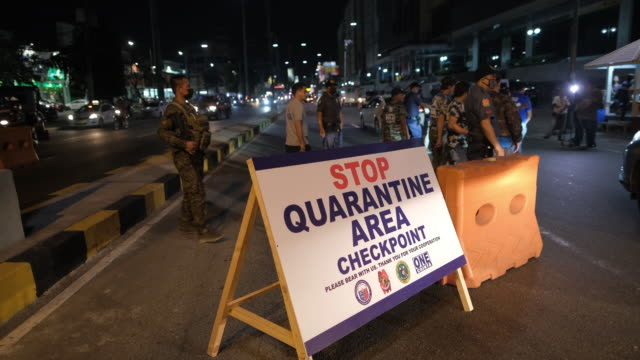 members of a quarantine team set up a checkpoint in cainta city, metro manila, the philippines, on saturday, march 14, 2020. president rodrigo... - philippines stock videos & royalty-free footage