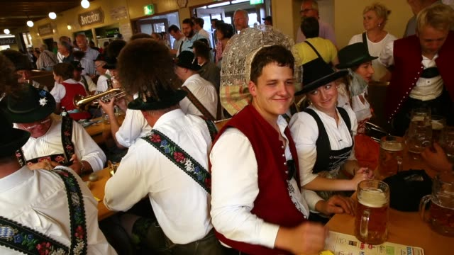 members of a traditional bavarian brass band play music while drinking beer in the paulaner tent following the oktoberfest parade of costumes of folk... - brass stock videos & royalty-free footage
