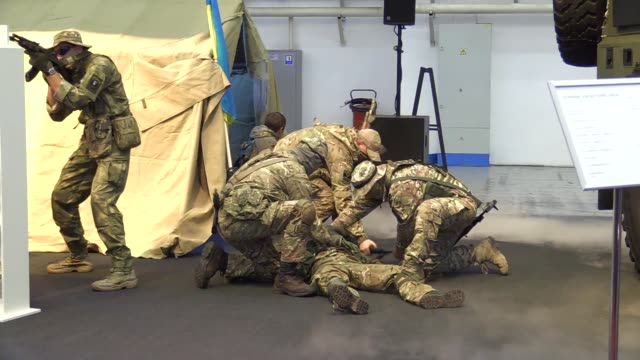 "members of a ukrainian tactical group perform a show during ""arms and security 2016"" exhibition in kiev, ukraine,11 october 2016. the xii... - security equipment stock videos & royalty-free footage"