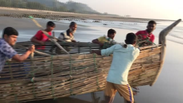 COX'S BAZAR BANGLADESH DECEMBER 20 Members of Alam and Sirac families sailing the Indian Ocean for fishing with their bamboo boat in Cox's Bazar...