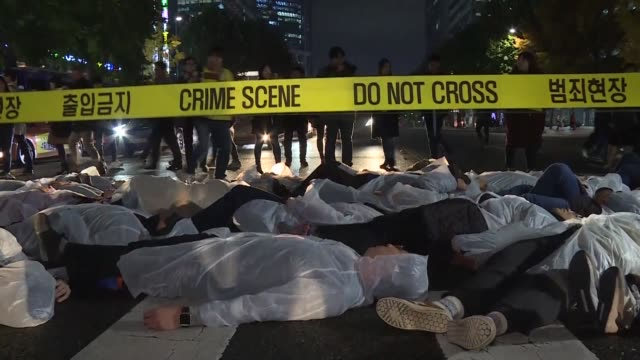 members of amnesty international perform a die in flash mob in seoul to commemorate the anniversary of the day a south korean farmer was struck by a... - flash mob stock videos and b-roll footage