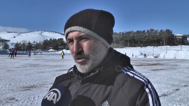 Members of an amateur division Turkish football team continue their daily training as usual after shoveling the snow in the field without caring the...