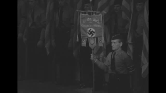 members of audience issue nazi salutes at german-american bund rally at madison square garden / low angle members of the organization's... - nazi swastika stock videos & royalty-free footage