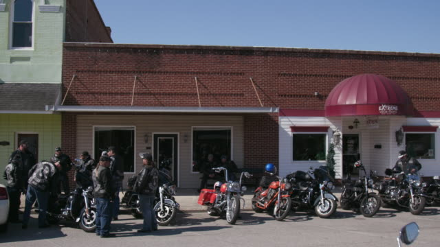 members of christian motorcycle club gathered outside store - motorcycle biker stock videos & royalty-free footage