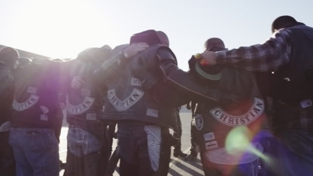 Members of Christian motorcycle club pray together