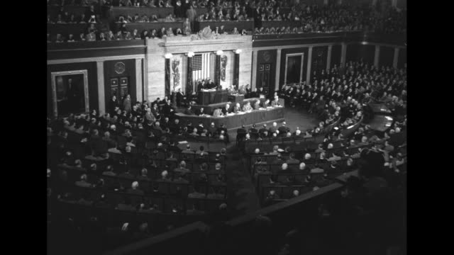 members of congress in house chamber rise to their feet applauding pan across to pres dwight eisenhower on rostrum vice president richard nixon... - joseph w. martin jr stock videos & royalty-free footage