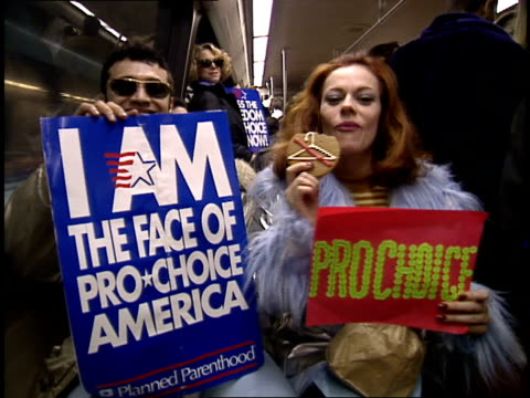 members of deeelite on bus with prochoice signs going to a protest in washington dc - abtreibung stock-videos und b-roll-filmmaterial