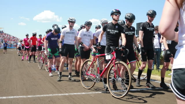 members of delta tau delta, and black key bulls are introduced at the beginning the men's little 500 bicycle race. - youth organisation stock videos & royalty-free footage