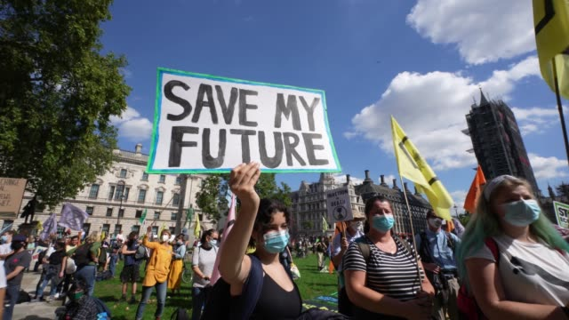 members of exhibition rebellion protest in parliament square highlighting the climate emergency as mps go back parliament after the summer recess on... - climate change stock videos & royalty-free footage