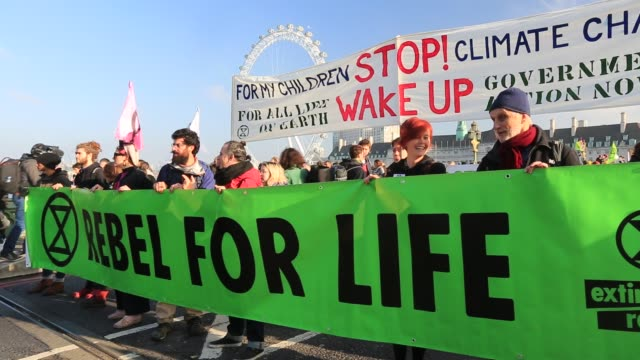 members of extinction rebellion close westminster bridge one of five london bridges across the river thames on saturday 17th november as part of... - real time stock videos & royalty-free footage