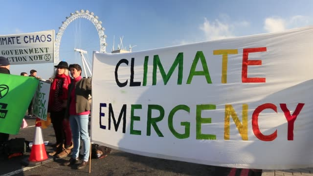 members of extinction rebellion close westminster bridge one of five london bridges across the river thames on saturday 17th november as part of... - placard stock videos & royalty-free footage