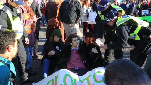members of extinction rebellion close westminster bridge one of five london bridges across the river thames on saturday 17th november as part of... - protestor stock videos & royalty-free footage