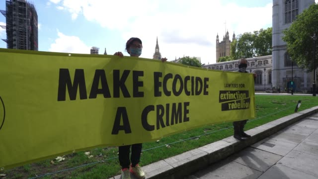 members of extinction rebellion unfurl a banner to mark the start of protest events to highlight the climate emergency at parliament square on august... - overexposed stock videos & royalty-free footage