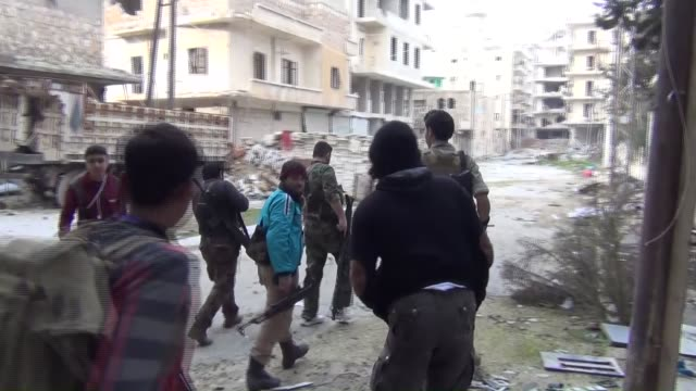 Members of Free Syrian Army and Islamic Front launch attacks to the buildings used as military headquarters by Assad Regime Forces in Ashrafiya...