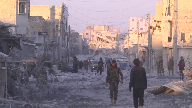 members of free syrian army celebrate in syria's albab after taking control of the district's centrum from daesh terrorists during the operation... - ブービートラップ点の映像素材/bロール