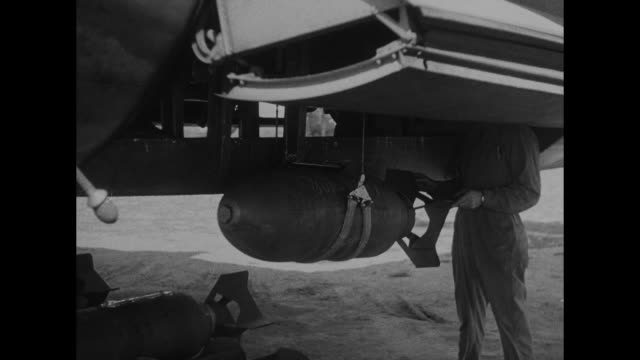 vs members of ground crew preparing bombs and loading them into b26 marauder bombers / parachute packs stacked outside building / flight crew member... - map marker stock videos and b-roll footage