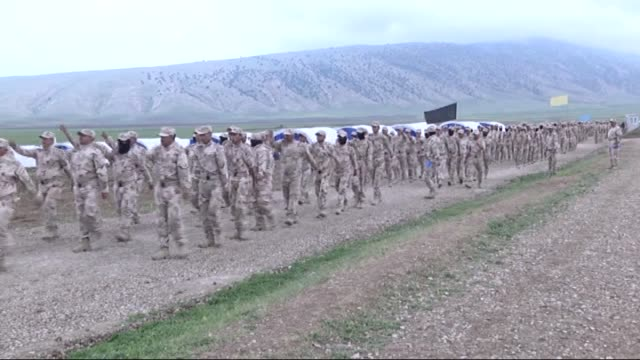 800 members of hashdi vatani forces get military training in a military camp in maklub mountain of seyhan district of mosul iraq to recapture mosul... - military camp stock videos & royalty-free footage