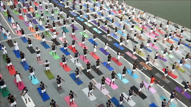 Members of India's Armed Forces take part in a yoga session to mark International Yoga Day on an aircraft carrier anchored in Mumbai
