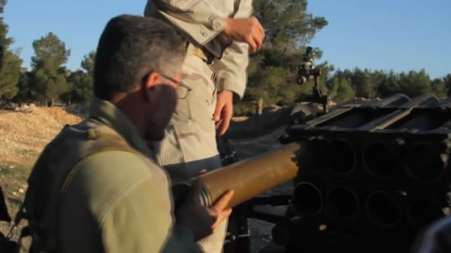 Members of Islamic Front a coalition of several rebel groups fighting in Syria attack Syrian regime forces with missiles during the clashes to secure...