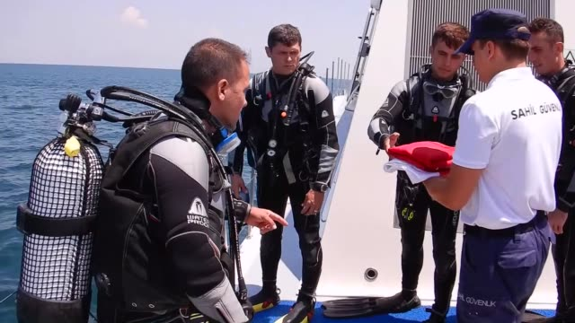 members of izmir based coast guard diving security safety search and rescue crew unfurl a flag underwater near a plane called 'gazi' for carrying... - reef stock videos & royalty-free footage