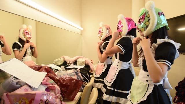 members of japanese pop group 'virtual currency girls' put on their masks ahead of performing onstage in tokyo japan on friday feb 16 photographer... - financial accessory stock videos and b-roll footage